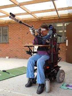 Ray Cockayne shooting .22 prone rifle from his wheelchair